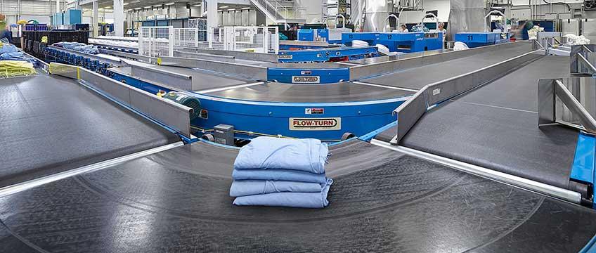 Nicely folded laundry on a conveyor belt